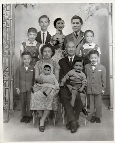 Adapting to the immigration laws that kept them apart, a local photography studio helped the Low family of New York create an impossible family portrait in 1961, by pasting in the faces of missing relatives. Courtesy of Museum of Chinese in America Collection.