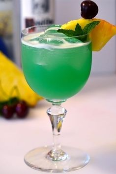 The green arrow- 1 part blue curacao, 1/2 oz ice (crushed), 1 oz lemon juice, 1/2 oz lime juice, 1 part gold tequila.