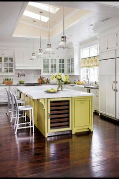 White kitchen with a pop of color on the kitchen island