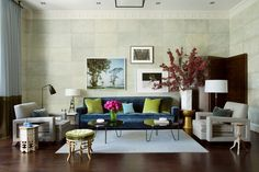 Wallpaper blocks by Cannon and Bullock add dimension to this layered Boston living room by Frank Roop, which includes a sofa upholstered in Donghia velvet and a pair of armchairs in Holly Hunt linen. All the furnishings are either vintage or Roop's design.