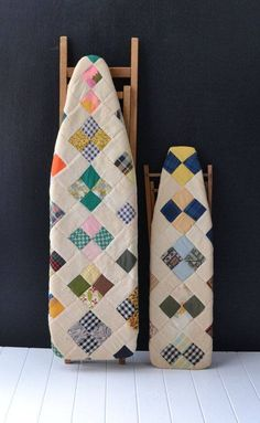 Neat way to use an old ironing board as quilt display