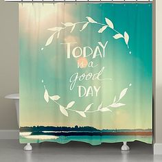 The Laural Home Today is a Good Day Shower Curtain is designed to add some inspiration and positivity to your bathroom décor. Featuring a beautiful scene of a sunny day over a lake, this uplifting shower curtain features the words Today is a Good Day.