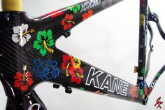 Custom painted flowers with exposed carbon fiber as the back drop.  This is a wild Kane triathlon bike. #custompaint #jackkane