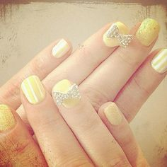 """Zooey Deschanel - """"Lemon yellow 3-D nail art for the #criticschoiceawards!"""" she Tweeted of her sparkly, eye-popping manicure."""