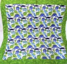 Baby or toddler flannel dinosaur blanket with green tie dye reversible side. Double layered soft cotton flannel, self binding style. The green layer of fabric is folded over to form the binding on the front layer. The corners are mitered. Measures approximately 34 square. The green tie dye fabric was used to simulate dinosaur skin!! Top stitched with a decorative curved pattern.  All fabrics have been pre-washed in unscented, hypoallergenic products. Care instructions: Machine wash in cool…