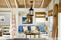 Extra dinner guests can squeeze onto the banquette. Cushions in Manuel Canovas's Cotton Club II are topped with pillows in Peter Fasano's Captiva fabric. Director's chairs from Marine Home Center move anywhere. Val Maitino Antiques' tole lantern hangs above the tablescape, completed with a John Robshaw striped throw.    - HouseBeautiful.com