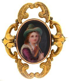 A GOLD BROOCH, SET WITH A PORCELAIN MINIATURE OF THE HEAD OF A BOY, UNMARKED, 29G  Sold @ Mellors & Kirk