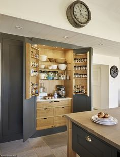 Sleek wooden panelling ensures your kitchen gadgets, herbs and spices can be neatly stored...