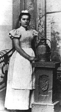 Maid, circa 1900. I'm surprised her arms are bare!