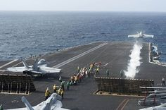 ARABIAN SEA(Aug.27,2013)F/A-18F Super Hornet of Swordsmen of Strike Fighter Squadron(VFA)32 launches from flight deck of aircraft carrier USS Harry S. Truman(CVN75)in support of Operation Enduring Freedom as 2nd Super Hornet waits to launch.Harry S. Truman,flagship for Harry S. Truman Carrier Strike Group, deployed supporting maritime security operations & theater security cooperation efforts in U.S. 5th Fleet area of responsibility.(USN Mass Comm Spec Seaman Laura Hoover)
