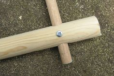 Screw together the two dowels to secure the frame.