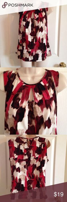 Calvin Klein sleeveless multi colored top, medium Calvin Klein sleeveless red multi colored top, medium. Chest 36, length 23. 95% polyester, 5% spandex. Great condition Calvin Klein Tops Blouses