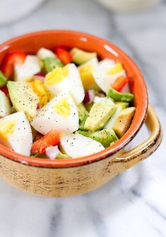 This egg and avocado bowl combines hard boiled eggs with creamy avocado slices for a super healthy & quick meal that's loaded with protein and healthy fat.