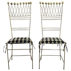 Awesome pair of gilt iron chairs in a harlequin style which look like a jester's crown with ball finials across its top. We are calling them Art Deco or Hollywood Regency. They are in wonderful ready-to-use vintage condition. The gilded iron has beautiful patina and the harlequin patterned seat slipcover is new. Circa 1920s-1950s. This fabulous pair of gilt iron chairs will be the perfect touch of whimsey to any room with any décor! We have deemed them Hollywood Regency or Art Deco with…