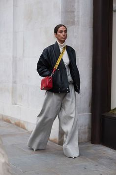 Street Style from London Fashion Week, pop of red outfit, wide leg pants, gray extreme wide leg pants, bomber jacket,