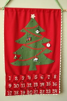 This is very similar to the Advent calendar I had growing up.  Our tree decorations were personalized (for example, a birthday cake embroidered with my sister's name for her birthday on December 8th)