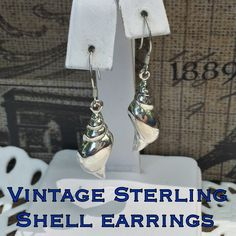 """1 DAY SALE 🎉Vintage Sterling Shell Drop Earrings This is a nice pair of vintage Sterling silver shell drop earrings. Measures 1.75"""" long X 0.75"""" wide. Marked 925 with another mark that I can't make out? These earrings are in great vintage condition. Perfect for Spring/ Summer! Please don't hesitate to ask any questions. Thanks for stopping by my closet! I ship out same day as purchase. Buy with confidence, over 261 5 star feedback. Please make REASONABLE offer using the offer feature only…"""