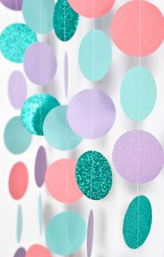 17 Ariel-approved ideas for a mermaid 30th birthday party, like this aqua, purple and coral paper garland.