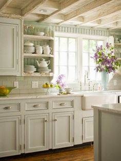FRENCH COUNTRY COTTAGE: French Cottage Kitchen Inspiration.  I would paint yellow instead of green :)