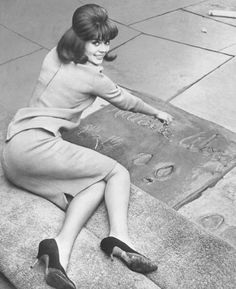 Natalie Wood lays her handprints, footprints & signature in wet cement at Grauman's Chinese Theater, Hollywood, June 1963.