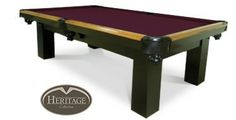 Colt Pool Table    Legacy Colt Pool Table.  Colt is value priced at under $1500. Styled in two-toned black wood finish with squared legs and oak rails, the Colt is a durable, well made pool table for your game room. Finished with black durahyde pockets and one inch slate. Only Heritage can offer so many quality details at a value price.