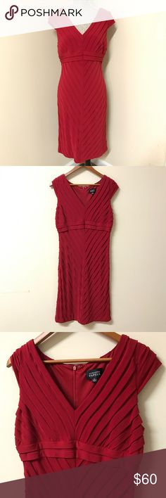"""Adrianna Papell Red Cocktail Dress Beautiful Adrianna Papell red cocktail dress. This would be perfect for date night or the holidays! Size 12 and fits true to size. Measures: 18.5"""" across chest from underarm to underarm but easily stretches to 21"""". Top of shoulder to bottom hem: 42"""". Excellent pre-owned condition! Adrianna Papell Dresses Midi"""