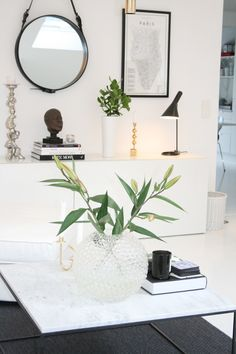 AJ table lamp by Arne Jacobsen from Louis Poulsen and Adnet mirror by Jacques Adnet from Gubi