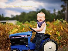 Fall tractor boy 1 one year old photo session birthday shoot