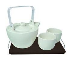 Tetera de cerámica con tazas a juego