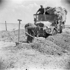 A soldier of the Rifle Brigade digging a trench to help camouflage and protect a Fordson WOT2 15cwt truck, 20 April 1942. Pin by Paolo Marzioli