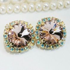 Swarovski clip on earrings! Available as drop or studs earrings too!