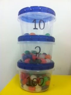 Scaffolding estimation understanding-  kids see what 10 and 100 look like and middle jar is what they are estimating...love it!