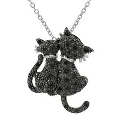 This sterling silver pendant features two black cats adorned with pave-set cubic zirconia stones.