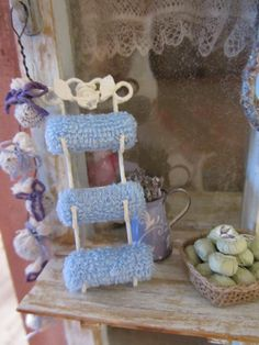 Towel Rack- Made with wire, jewelry findings, cut up baby wash cloths