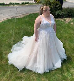 This gorgeous, plus size wedding dress is absolutely jaw dropping! Featuring an a-line silhouette, V neckline, illusion with lace on the back, soft tulle skirt and delicate lace on the bodice! #ImAtEO #elegant #elegantoccasions #plussize #plussizeweddingdress #wedding #weddingideas #weddingdress #aline #alineweddingdress #lace #vneck #weddingdresslace #bride #bridetobe #2021bride #2022bride #2023bride Plus Size Prom, Bridesmaid Dresses Plus Size, Plus Size Wedding, Prom Dresses, Bridal Gowns, Wedding Gowns, Bodice, Neckline, Bridal Suite