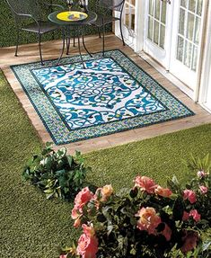 Spruce up your porch with the Easy Drainage Outdoor Rug. It features small drain holes that allow water to pass through easily yet are invisible to the naked eye. Great for use on a patio or deck! Soft polyester face with PVC backing for slip resistance.