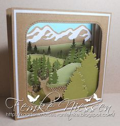 """Made by Femke Niessen: deer landscape (landscape in a different way) Tools: mft dienamics """"stitched snowdrifts, inside out rounded square stax"""", yvonne creations """"mountain"""", Marianne Design """"forest, pinetrees"""", memorybox """"tree border"""", impression opsession """"grazing deer""""."""
