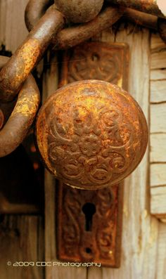 Lovely Rusted Farmhouse Door Knob.: Relates to color of pin and rounded shape  head and covering.
