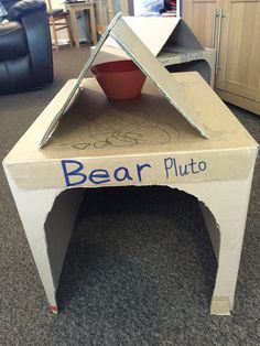 At first this box was the right way up, child would hide inside and close the flaps. Then it was a car with a plate for a steering wheel before it went on to become a doghouse and child climbed in  put a bowl outside and made its home as a doggy