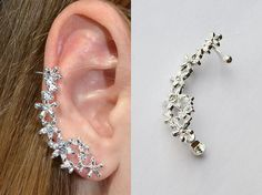 Shop put  favorites, we often have discounts and promotions! Pls, keep an eye on the store - https://www.etsy.com/ru/shop/EarringsEarcuffs      I make a gift with every order :)        Elegant Cuff with large rhinestones inserted into a frame of silver metal - a great gift for any holiday. Delicate sparkling flowers on your ear, are a wonderful attribute. This Cuff - highlight your personality and will add to your image of femininity and tenderness. Suitable to any style of clothing from…