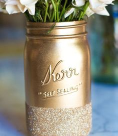 Party Centerpiece- Meet your new favorite way to decorate at a wedding, bridal shower, or birthday party. Place one of these sparkling vases on the dinner table, a window sill, or a mantel for an eye-catching display. Click through to redbookmag.com for more clever ways to repurpose your mason jars.