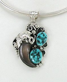 Native American bear claw pendant Navajo Sterling Silver and turquoise by Betty Bitsie
