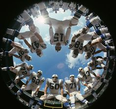 Fisheye camera view of Baltimore Colts QB Earl Morrall and teammates in huddle during a 1968 practice at Memorial Stadium