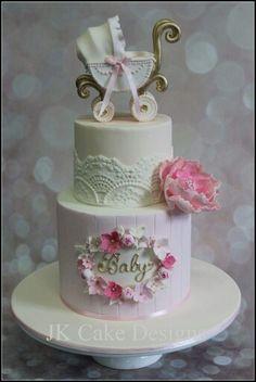 Baby Girl shower cake with pram topper.