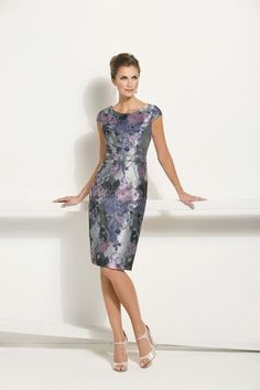 Jasmine Bridal Mother of the Bride-Groom Dress Jasmine Black Label Style M170018 in Lilac. Make a statement with this beautiful and extravagant gown at your next special occasion. This floral jacquard dress lets the fabric speak for itself and features a scoop neckline and sheath skirt.