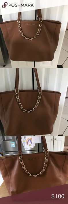 Michael kors Harper tote east west EUC Michael kors Harper tote east west in amazing condition. So gorgeous tho. In the color luggage.  Has beautiful chains on both sides of bags with three interior pockets. The middle pocket has a zipper. MICHAEL Michael Kors Bags Totes