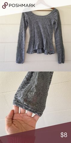 Long sleeve Hollister shirt Long sleeve dark grey Hollister shirt size xsmall. Has lace on sleeves bottom half of shirt flares out Hollister Tops Blouses