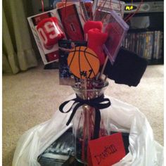 A Dozen Roses- my boyfriend loves Derrick Rose from the Chicago Bulls so I made him a birthday gift with 12 Rose items placed it in a flower-like arrangement :) Best Groomsmen Gifts, Groomsman Gifts, Bf Gifts, Party Gifts, Starburst Bracelet, Crafts To Make, Diy Crafts, Dozen Roses, Derrick Rose