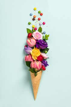 Ice Cream Cone With Flowers And Sprinkles Summer Minimal Concept. Ice cream cone with flowers and sprinkle.