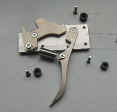 Crossbow Trigger Mechanism (simple But Sturdy): AhoihoiToday we make a trigger/lock mechanism for a rather powerful crossbow, would also work for BB guns though.Both of my BB guns use this design. Crossbow Parts, Diy Crossbow, Crossbow Arrows, Crossbow Hunting, Arrow Quiver, Archery Hunting, Homemade Crossbow, Homemade Weapons, Survival Weapons